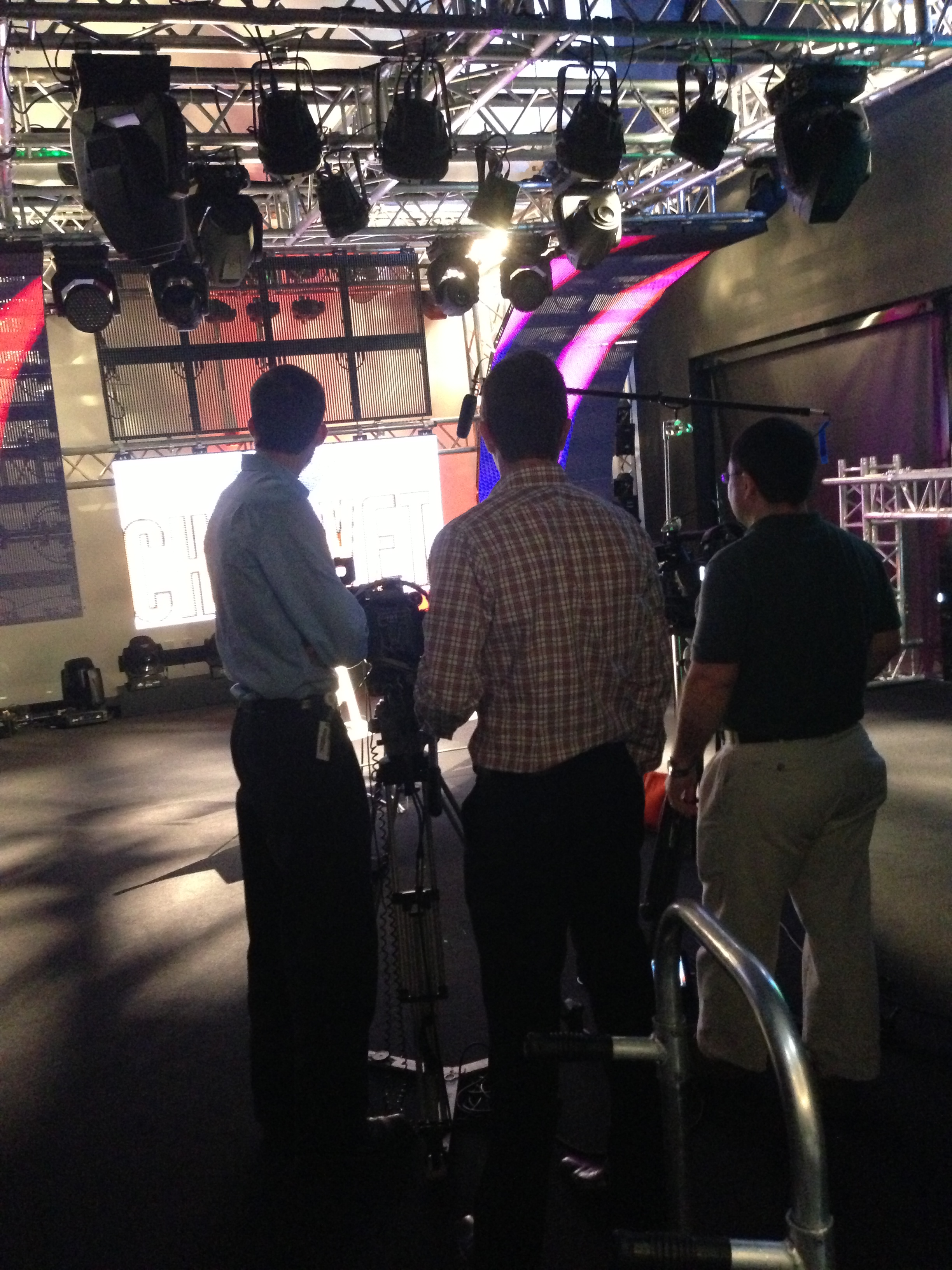 JM Family crew setting up in front of CHAUVET  Professional VIP video products under a full Chauvet rig.